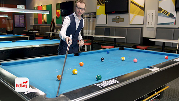 Analyzing the pool ball's layout after a 9 ball break to determine the spot to place the cue ball for the best chance to run out the rack.