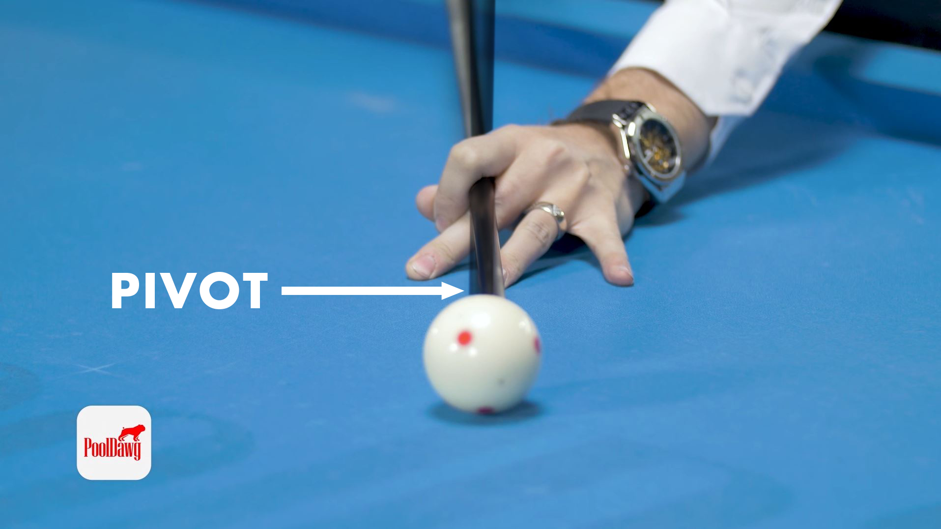 Florian lines up a left cut shot, planting his bridge hand with one tip of left English and then pivots with the back hand to align the tip to the center of the cue ball.