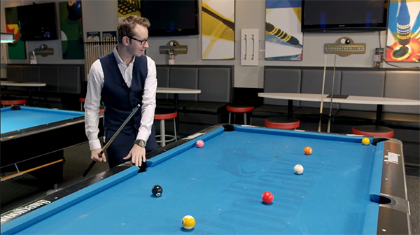 Florian checks his cue ball position, possible shots, and his pocketed balls on an ideal 10-ball break
