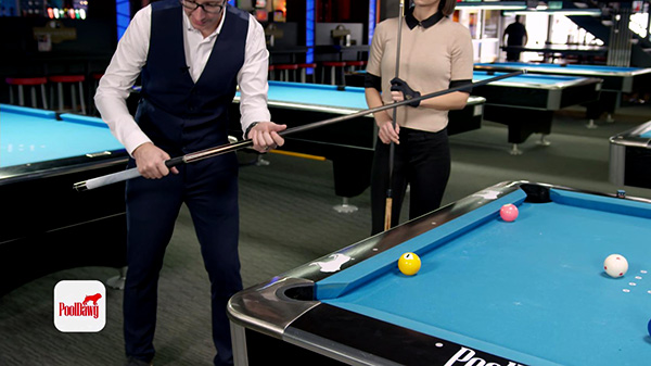 For shots close to the rail, a shorter grip on the cue is needed