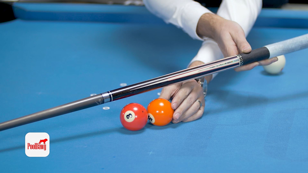 """Valerie lines up the five ball to visualize the aiming position referred to as the """"ghost ball"""""""