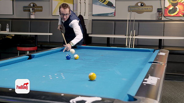Florian uses his full break cue and a longer stroke to jump the ball between the two and nine.