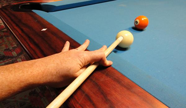 closed hand pool cue bridge