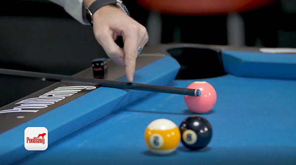 Florian uses his cue to measure the distance between the channel and his point of impact on the object ball.