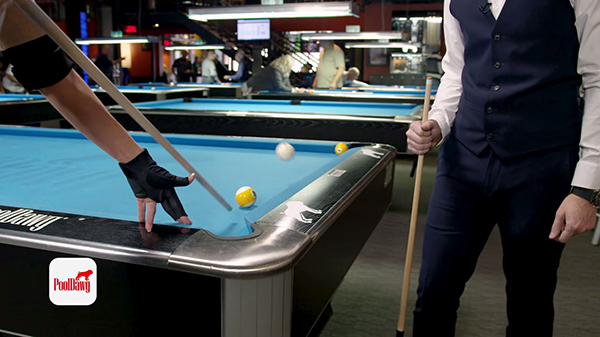 Valerie jumps the cue ball with a short, powerful stroke