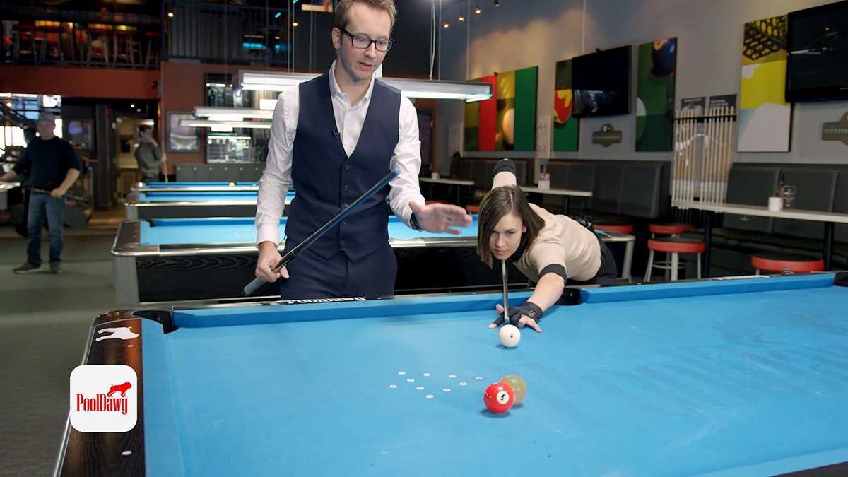 """Valerie aims her shot, shooting to replace the """"ghost ball"""" with the cue ball and cut the three ball into the corner pocket."""
